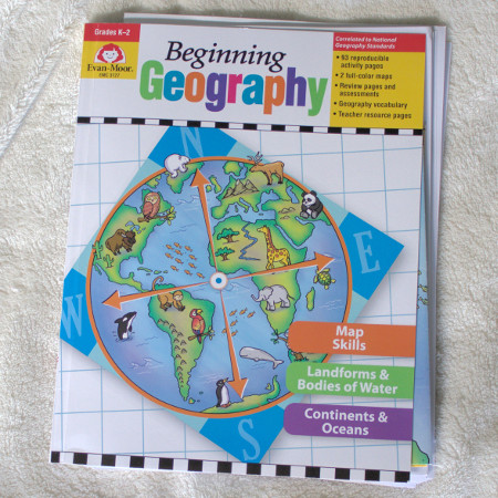 Evan-Moor Beginning Geography gives a simple introduction to reading and creating maps. It also includes basic world geography.